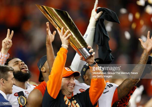Clemson head coach Dabo Swinney celebrates with teammates after Clemson beat Alabama 4416 to win the College Football Playoff National Championship...