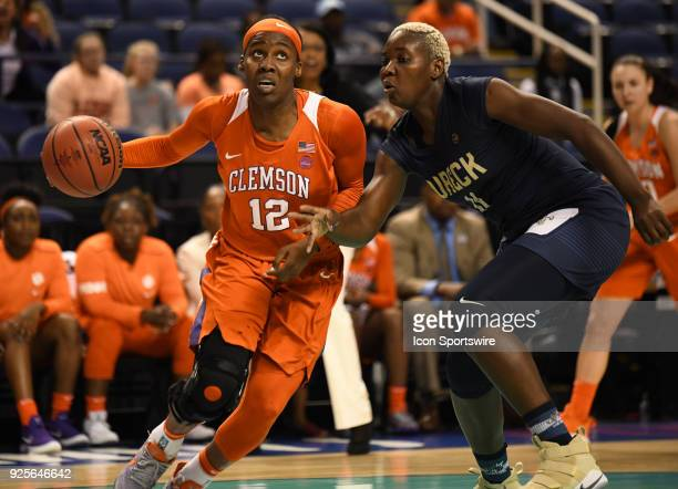 Clemson Lady Tigers guard Aliyah Collier drives by Georgia Tech Yellow Jackets forward Elo Edeferioka during the ACC women's tournament game between...