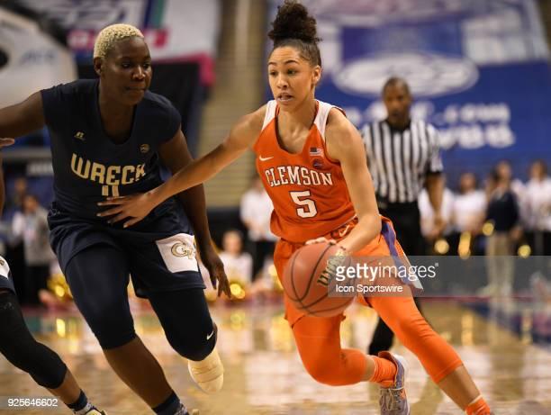 Clemson Lady Tigers guard Danielle Edwards drives by Georgia Tech Yellow Jackets forward Elo Edeferioka during the ACC women's tournament game...