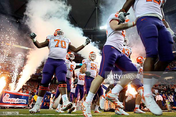 Clemson offensive guar Jamarcus Grant and the Clemson team head out of the tunnel before the start of the ChikfilA Bowl against Auburn at the Georgia...