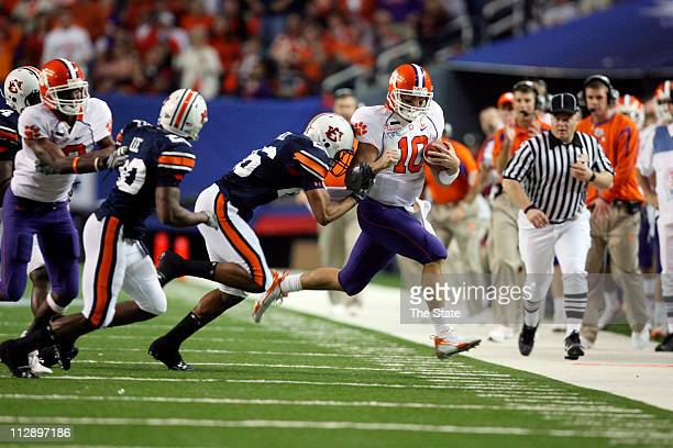 Clemson quarterback Cullen Harper carries for a first down against Auburn in the second quarter of the ChikfilA Bowl at the Georgia Dome in Atlanta...