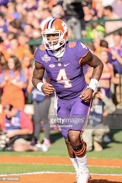 Clemson quarterback Deshaun Watson runs back to the bench following his running touchdown during 1st half action between the Clemson Tigers and the...