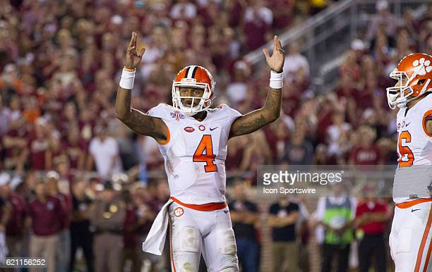 Clemson quarterback Deshaun Watson signals for a touchdown during an NCAA football game between the Florida State Seminoles and the Clemson Tigers on...