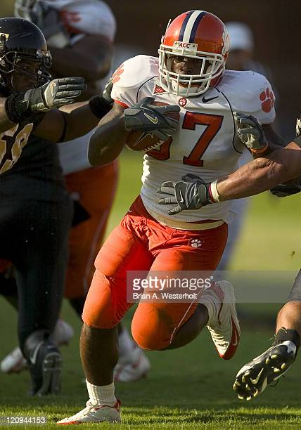 Clemson RB Reggie Merriweather avoids Wake Forest linebackers Aaron Curry and Jonathan Abbate as he scampers 14-yards for a touchdown during the...