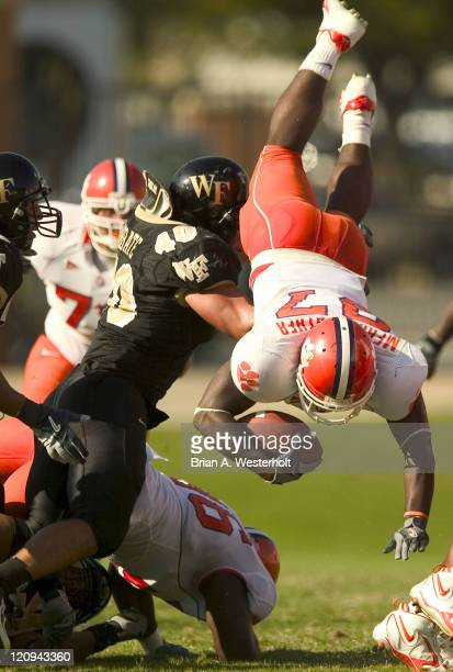 Clemson RB Reggie Merriweather is upended by Wake Forest LB Jonathan Abbate during first half action at Groves Stadium in Winston-Salem, NC, October...