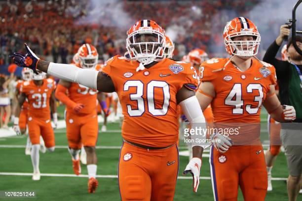 Clemson takes the field for the College Football Playoff Semifinal at the Cotton Bowl Classic between the Notre Dame Fighting Irish and the Clemson...