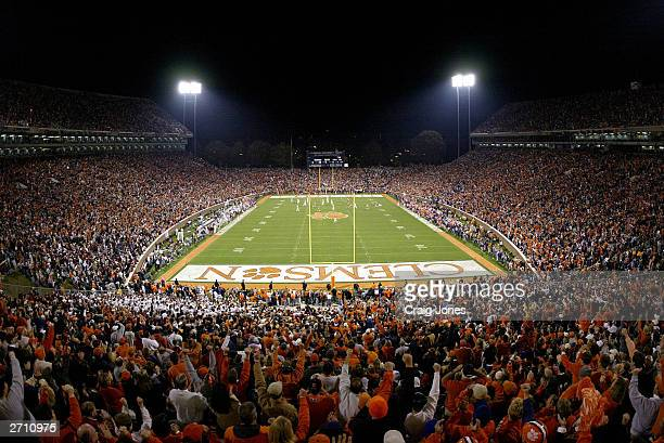 Clemson Tiger Fans cheer at the start of their game against the Florida State Seminoles on November 8 2003 at Memorial Stadium in Clemson South...