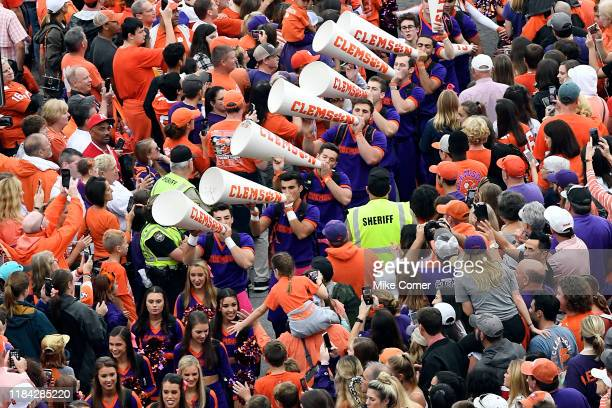 Clemson Tigers cheerleaders lead fans in a cheer during the Tiger Walk prior to the Tigers' homecoming football game against the Boston College...