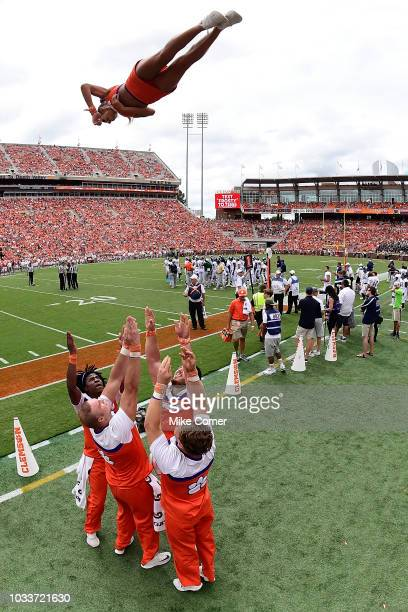Clemson Tigers cheerleaders perform a stunt during a stoppage in play of the Tigers' football game against the Georgia Southern Eagles at Clemson...