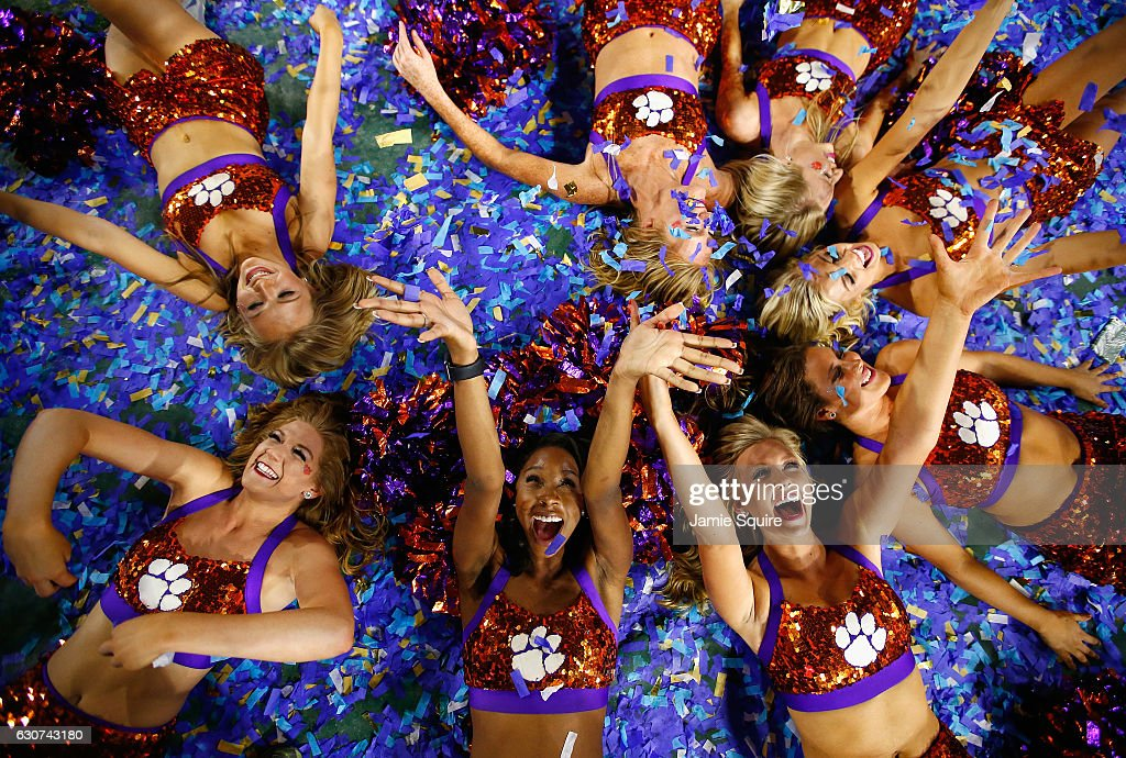 Clemson Tigers cheerleaders play in confetti after the Clemson Tigers beat the Ohio State Buckeyes 31-0 to win the 2016 PlayStation Fiesta Bowl at University of Phoenix Stadium on December 31, 2016 in Glendale, Arizona.
