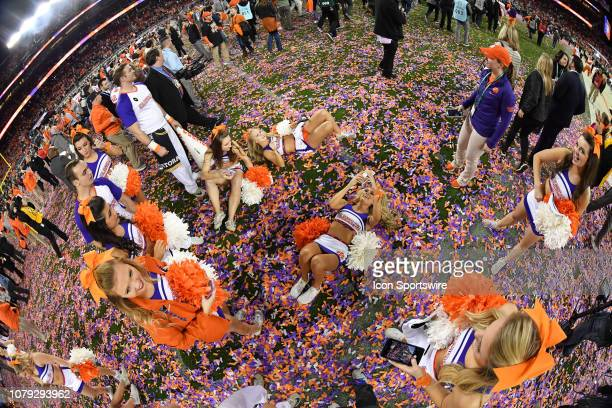 Clemson Tigers cheerleaders take selfies in the confetti after the Clemson Tigers defeated the Alabama Crimson Tide in the College Football Playoff...