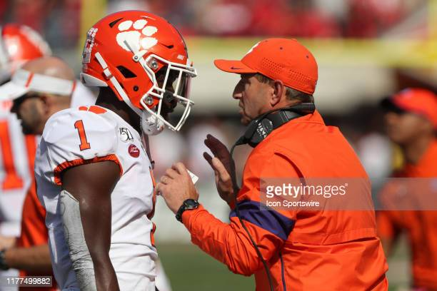 Clemson Tigers cornerback Derion Kendrick talks with head coach Dabo Swinney during the game against the Clemson Tigers and the Louisville Cardinals...