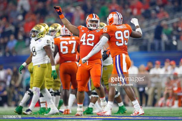 Clemson Tigers defensive lineman Christian Wilkins and defensive end Clelin Ferrell celebrate a sack during the CFP Semifinal Cotton Bowl Classic...