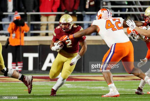 Clemson Tigers defensive tackle Christian Wilkins moves in on Boston College running back AJ Dillon during a game between the Boson College Eagles...
