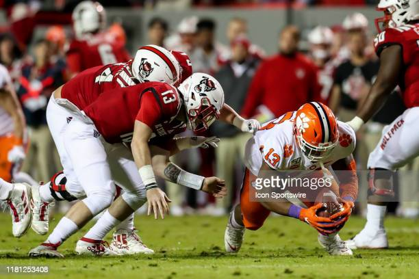 Clemson Tigers defensive tackle Tyler Davis covers the ball fumbled by North Carolina State Wolfpack quarterback Devin Leary during an NCAA Football...