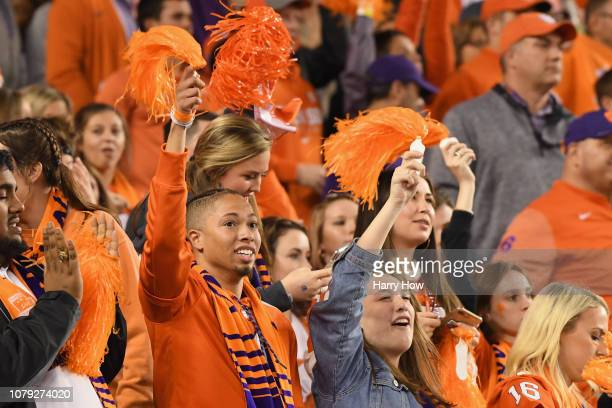 Clemson Tigers fans celebrate their teams lead against the Alabama Crimson Tide during the third quarter in the CFP National Championship presented...