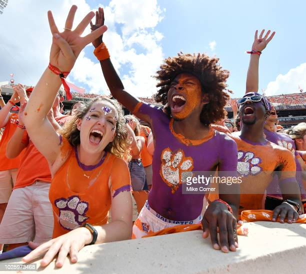 Clemson Tigers fans raise four fingers prior to the start of the fourth quarter of the Tigers' football game against the Furman Paladins at Clemson...