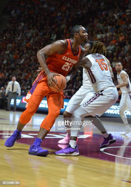 Clemson Tigers forward Aamir Simms goes in for a shot while being defended by Virginia Tech Hokies forward Chris Clarke during a college basketball...