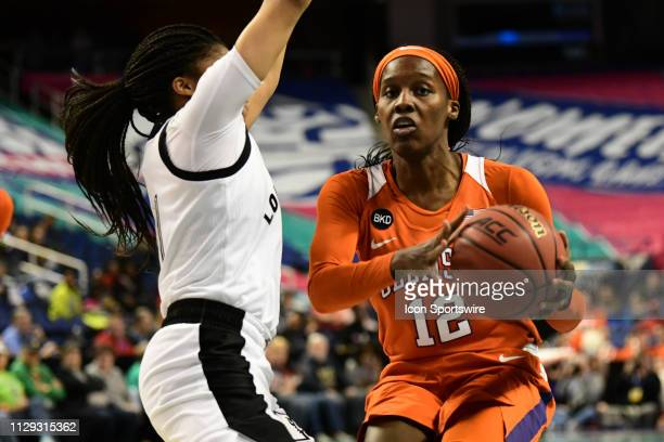 Clemson Tigers guard Aliyah Collier looks to pass under the basket during the ACC Women's basketball tournament between the Louisville Cardinals and...