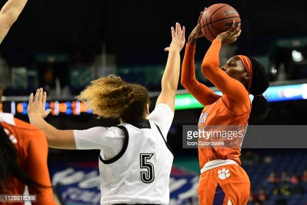 Clemson Tigers guard Aliyah Collier shoots over Louisville Cardinals guard Mykasa Robinson during the ACC Women's basketball tournament between the...