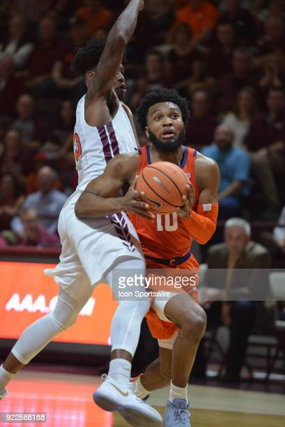 Clemson Tigers guard Gabe DeVoe drives while being defended by Virginia Tech Hokies guard Ahmed Hill during a college basketball game on February 21...
