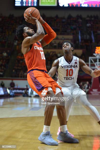 Clemson Tigers guard Gabe DeVoe shoots while being defended by Virginia Tech Hokies guard Justin Bibbs during a college basketball game on February...