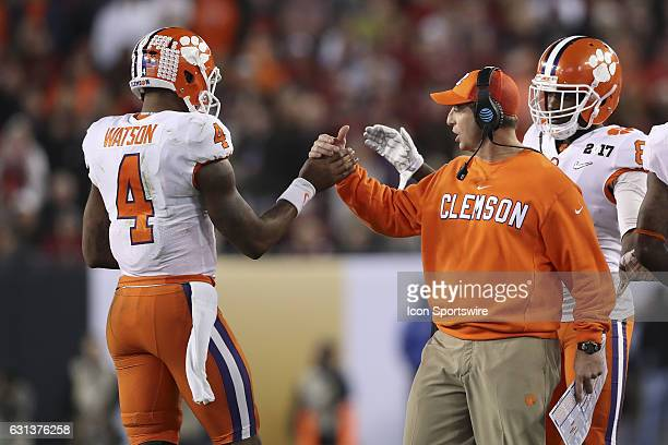 Clemson Tigers head coach Dabo Swinney congratulates Clemson Tigers quarterback Deshaun Watson after he threw a pass for a touchdown in the 4th...