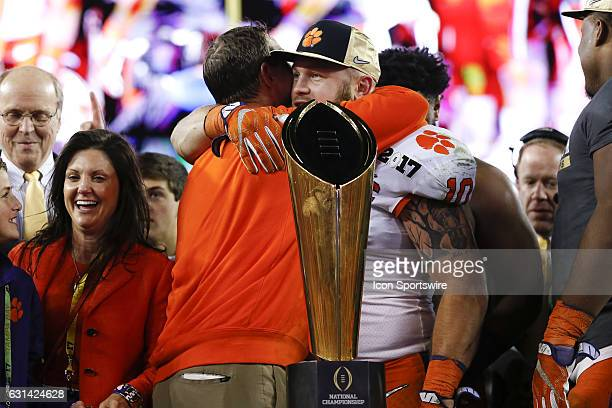 Clemson Tigers head coach Dabo Swinney hugs Clemson Tigers linebacker Ben Boulware behind the National Championship Trophy after the 2017 College...