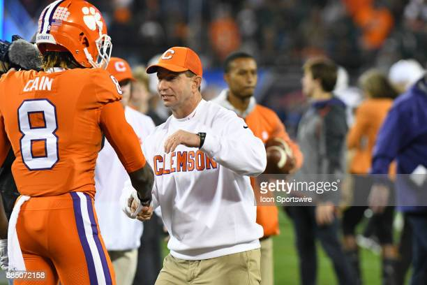 Clemson Tigers head coach Dabo Swinney makes his way down the practice line shaking hands with Clemson Tigers wide receiver Deon Cain during the ACC...