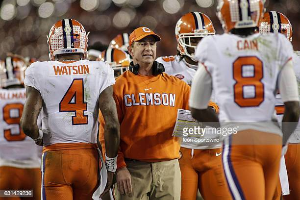Clemson Tigers head coach Dabo Swinney rounds up players during the College Football Playoff National Championship game between the Alabama Crimson...