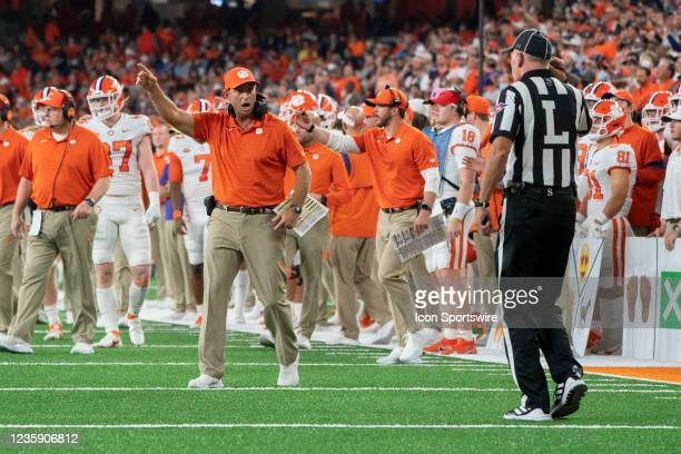 Clemson Tigers Head Coach Dabo Swinney speaks with the Line Judge during the first half of the College Football game between the Clemson Tigers and...