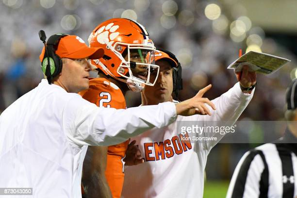 Clemson Tigers head coach Dabo Swinney talks to Clemson Tigers quarterback Kelly Bryant before he heads back in the game during the game between the...