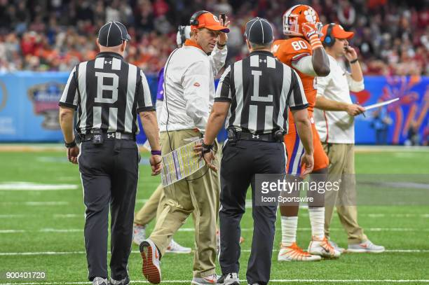 Clemson Tigers head coach Dabo Swinney talks to the line judge during a timeout late in the game during the College Football Playoff Semifinal at the...