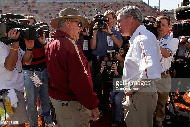Clemson Tigers Head Coach Tommy Bowden right and Florida State Seminoles Head Coach Bobby Bowden left share some words in front of the cameras after...