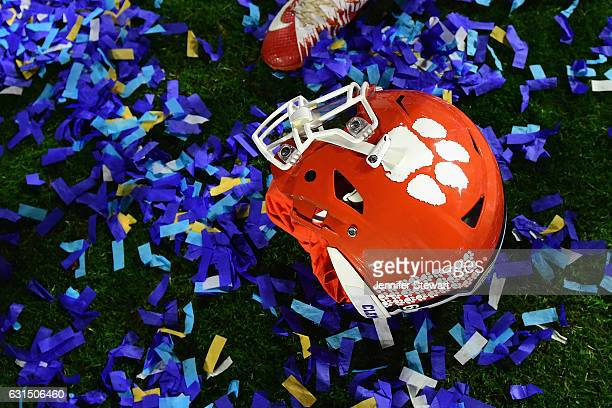 Clemson Tigers helmet is seen on confetti after the Clemson Tigers beat the Ohio State Buckeyes 310 to win the 2016 PlayStation Fiesta Bowl at...