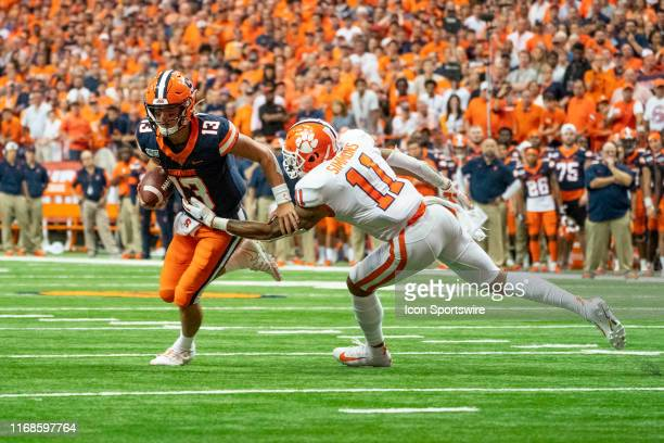 Clemson Tigers Linebacker Isaiah Simmons tackles Syracuse Orange Quarterback Tommy DeVito during the second half of the game between the Clemson...