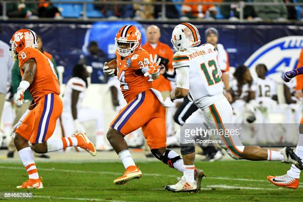 Clemson Tigers linebacker Kendall Joseph runs down field after getting an interception on a pass thrown by Miami Hurricanes quarterback Malik Rosier...
