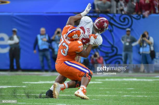 Clemson Tigers offensive tackle Tremayne Anchrum attempts to pull down Alabama Crimson Tide defensive lineman Da'Ron Payne during an early second...