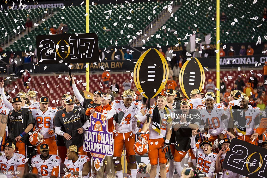 Clemson Tigers players celebrate the win in the College Football Playoff National Championship game between the Alabama Crimson Tide and the Clemson Tigers on January 9, 2017, at Raymond James Stadium in Tampa, FL. Clemson won the game 35-31.