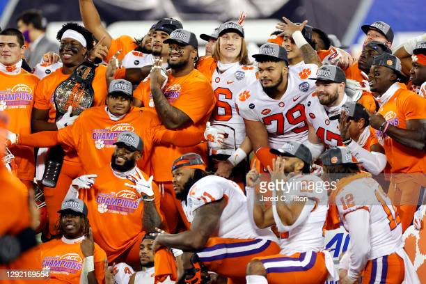 Clemson Tigers players pose after defeating the Notre Dame Fighting Irish 34-10 in the ACC Championship game at Bank of America Stadium on December...