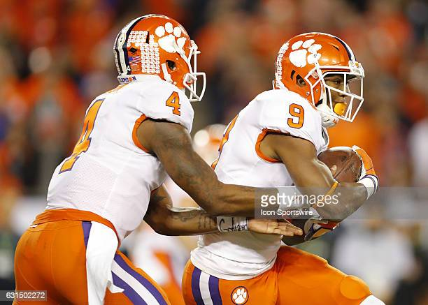 Clemson Tigers quarterback Deshaun Watson hands the ball off to running back Wayne Gallman during first half action of the National Championship game...