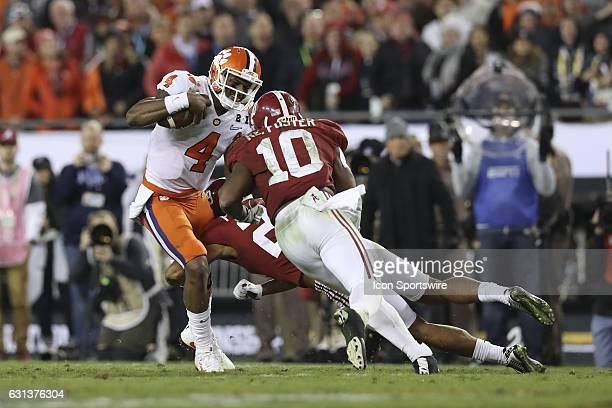 Clemson Tigers quarterback Deshaun Watson is tackled by Alabama Crimson Tide defensive back Minkah Fitzpatrick and Alabama Crimson Tide linebacker...
