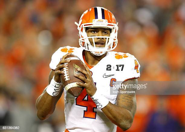 Clemson Tigers quarterback Deshaun Watson looks to pass during first half action of the National Championship game between the Alabama Crimson Tide...