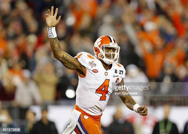 Clemson Tigers quarterback Deshaun Watson reacts after a Clemson touchdown in second half action of the National Championship game between the...