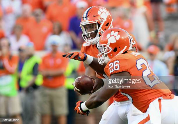 Clemson Tigers quarterback Kelly Bryant hands the ball off to Clemson Tigers running back Adam Choice on September 23 2017 at Memorial Stadium in...