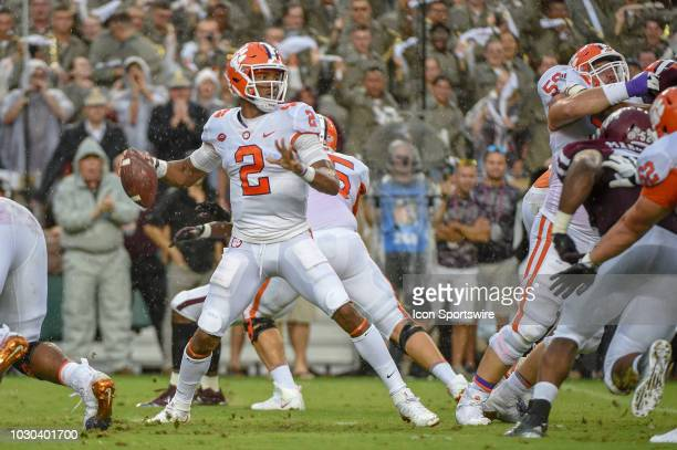 Clemson Tigers quarterback Kelly Bryant looks to throw a wet ball downfield during soggy first half action during the college football game between...