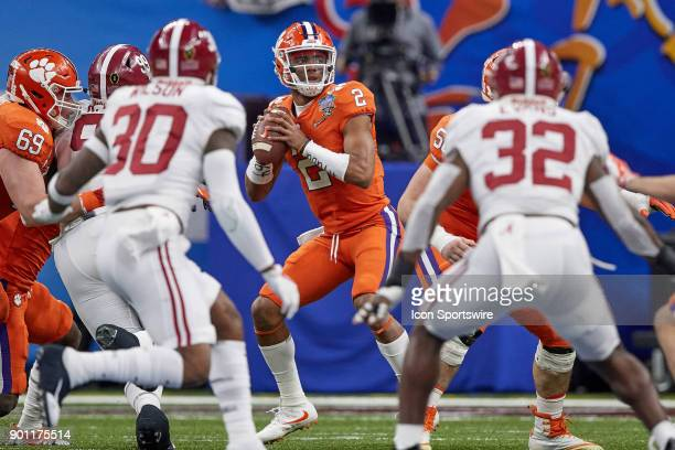 Clemson Tigers quarterback Kelly Bryant looks to throw the football during the College Football Playoff Semifinal at the Allstate Sugar Bowl between...