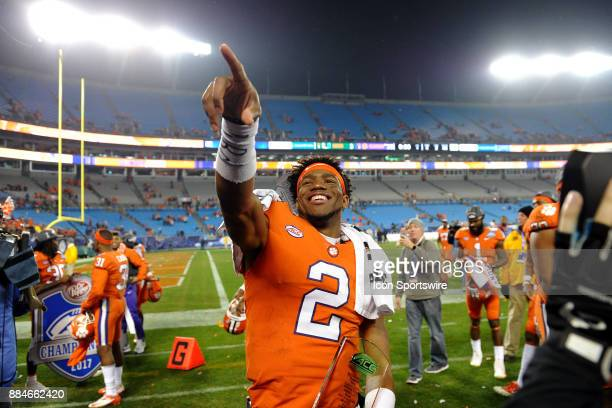 Clemson Tigers quarterback Kelly Bryant points to someone in the stands as he walks around the field with his MVP trophy after the ACC Championship...