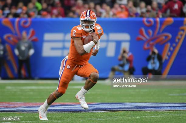 Clemson Tigers quarterback Kelly Bryant scrambles from the pocket in front of the ESPN logo during the College Football Playoff Semifinal at the...