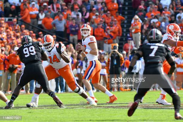 Clemson Tigers quarterback Trevor Lawrence looks to pass in the pocket during the game between the Clemson Tigers and the South Carolina Gamecocks on...